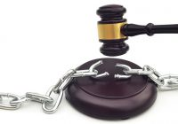 Gavel breaking a chain